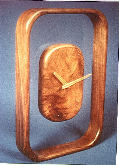 Exotic Wood Clock Clock Pictured In Walnut And Acrylic