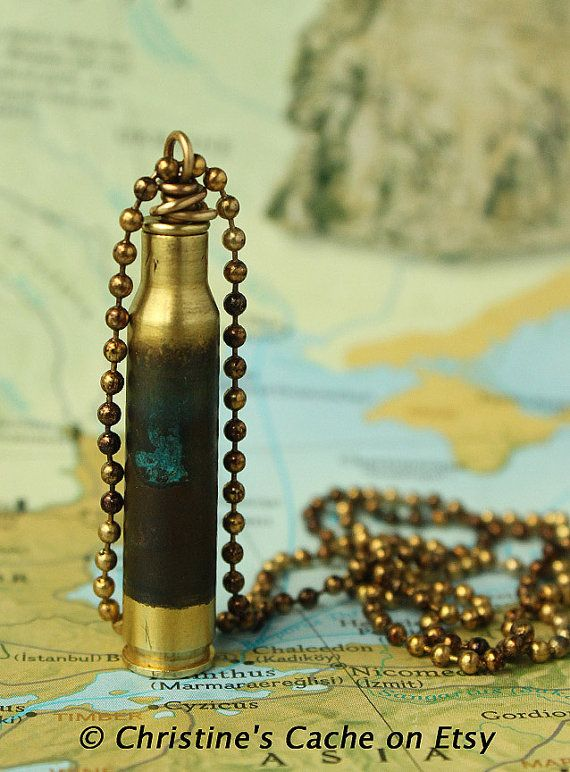 Beautiful 223 brass rifle shell with green patina finish. Made into a secret stash vial with a brass cap, bailed so you can wear it on a chain.