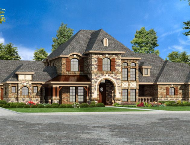 This opulent luxury floor plan features varied ceilings bringing life to each space. The Stoneleigh Heights mansion floor plan impresses with its stone exterior.