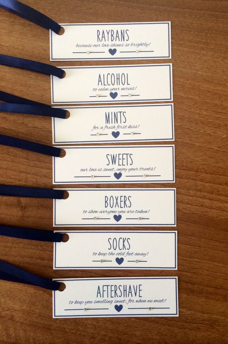 Groom Survival Kit Tags - White Card with Navy Blue Ribbon. These gift tags are the perfect accompaniment to the presents you will give your groom on the morning of your wedding. Each tag has a cute love heart and finished with clear diamantés to add that extra sparkle! Minimum order of 6 tags per order which cost £3.50 plus p&p. There are other ribbon colours and card options available to match the theme of your wedding.