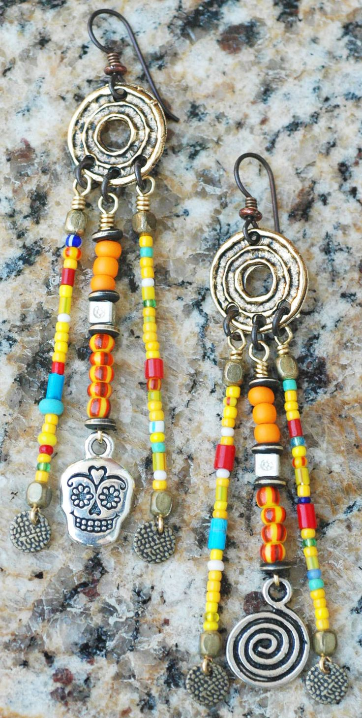 Kumasi Chandelier Earrings: African Tribal Colorful Glass Trade Bead, Spiral and Skull Chandelier Earrings $75 Click to buy