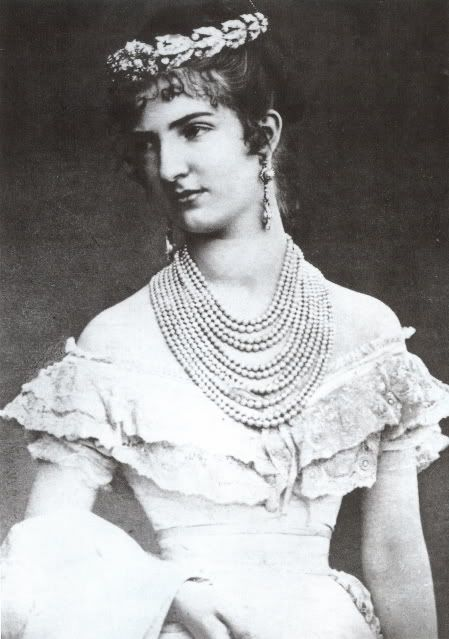 Portrait of Queen Margarita as a bride. On this picture, she wears a tiara created   by Mellerio offered in wedding present by her father-in-law King Victor Emmanuel II   of Italy