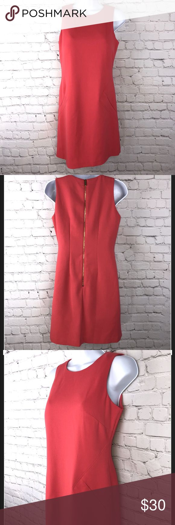 Vince Camuto shift dress Beautiful classic shift dress. Perfect for Spring! Coral colored, polyester blend with a zip up in the back and underneath lining. Like new! Women's petite 2 , refer to photos for measurements.  Excellent pre owned condition! Vince Camuto Dresses Strapless