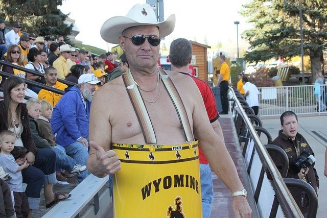 Cowboy Ken wears a barrel, suspenders, hat, glasses, cowboy boots....and that's about it- to each University of Wyoming football game.