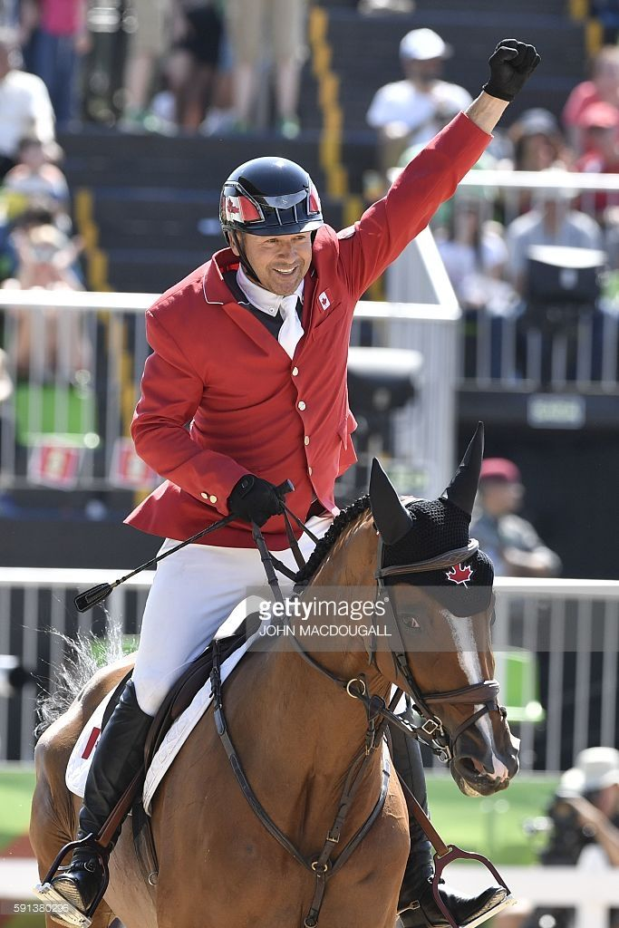 Canada's Eric Lamaze riding Fine Lady 5 takes part in the jumping competition at the Olympic Equestrian Centre during the Rio 2016 Olympic Games in Rio de Janeiro on August 17, 2016
