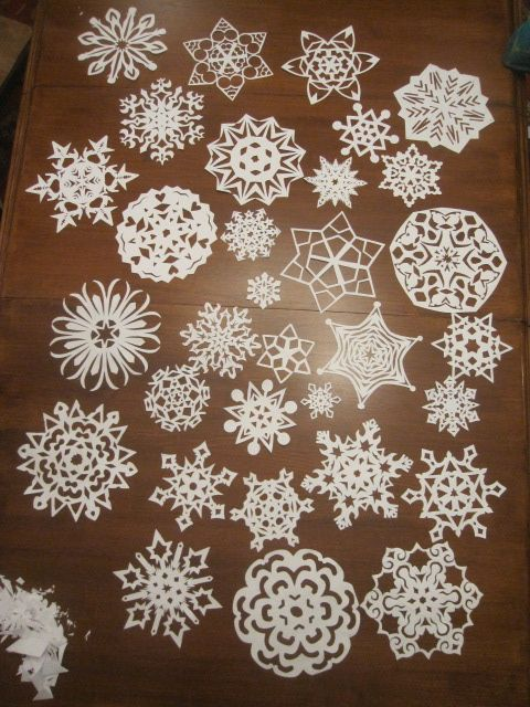 Snowflake Tutorial.  After the snowflakes are cut, lightly spray with spray starch, then press with a hot iron.  The starch helps to give them a little stiffness, and hold together better.  Don't get them too wet, and don't slide your iron, just press it down, lift and press.  Keep it there long enough to dry the starch.