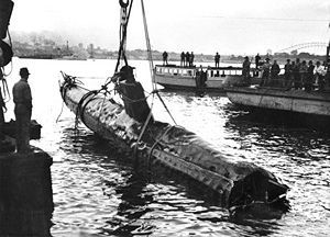 A Japanese Ko-hyoteki class midget submarine, believed to be Midget No. 14, is raised from Sydney Harbour the day after the attack.