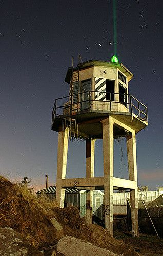 https://flic.kr/p/rP7AD   Fort Ord Prison Watch Tower   My wife has this cool green laser pointer that I took with me during a full moon shoot at Fort Ord. In this shot I used it to shine into the spot light mounted on top of the watch tower.