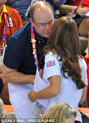 Kate, Duchess of Cambridge greeting Prince Albert of Monaco at synchronized swimming during London Olympics. August 9, 2012.