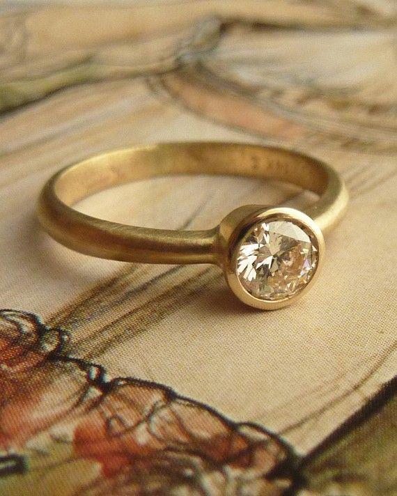 bezel set yellow gold diamond ring, sandblasted finish. Totally making this design for my old mine cut antique yellow diamond :)