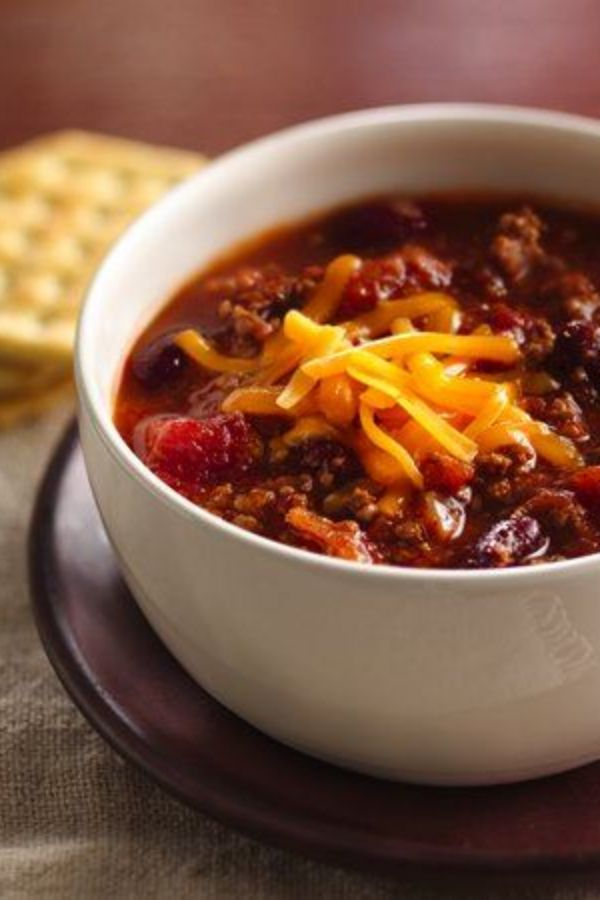 Set aside 20 minutes of prep time in the morning, and you'll have a hearty, fragrant chili simmering in the slow cooker when you get home. Perfect for cold nights or snowy weekends, this family fave requires hardly any work—and it's super affordable. Freeze the leftovers for lunches—or topping chili dogs—later.