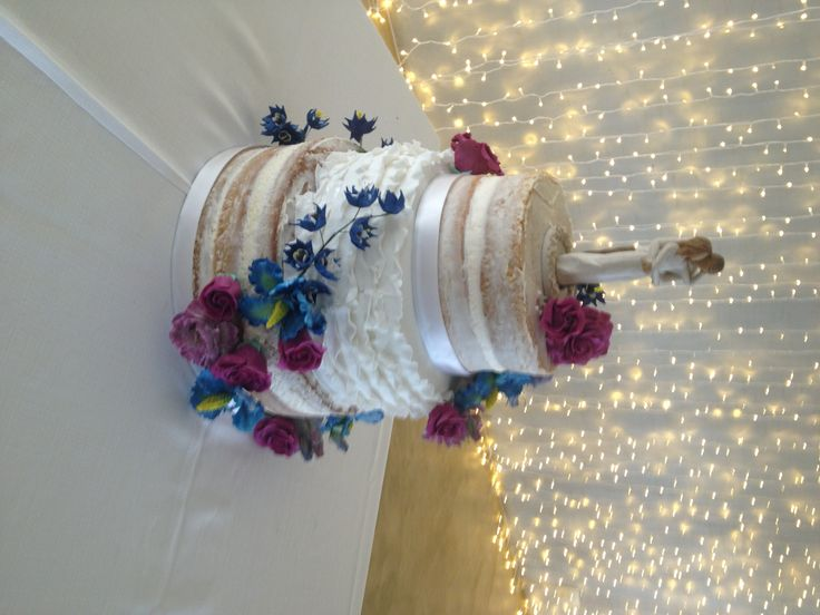 Three Tier Semi Naked and Fondant Ruffle Wedding Cake with Magenta and Royal Blue Floral Decor