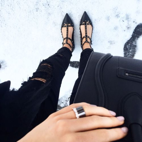 shebysmd:  All Black   Black ripped jeans with Valentino RockStud Cage Flats and Céline Luggage Tote in the snow.   S H E
