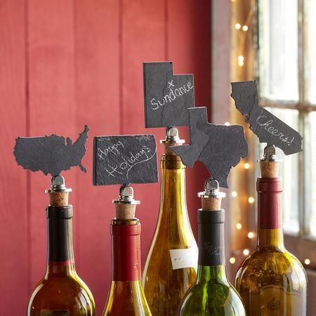 "SLATE STATE WINE STOPPERS - Show pride in the states you love with these whimsical state-shaped bottle stoppers. Choose from 50 states (Michigan does not include the Upper Peninsula) plus the continental U.S. Made of gray slate, metal and cork, chalk included. USA. Each approx. 5"" x 6""."