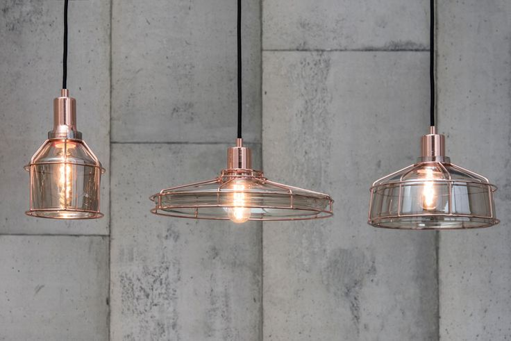The first three pendants in our Ombre range, Sleek, Slim and Curve. Champagne glass covered with a shiny copper cage and a single filament inside!