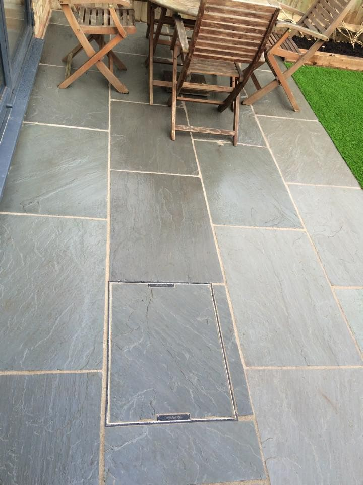 drain cover / stretcher bond tiles / lawn edge same level as patio