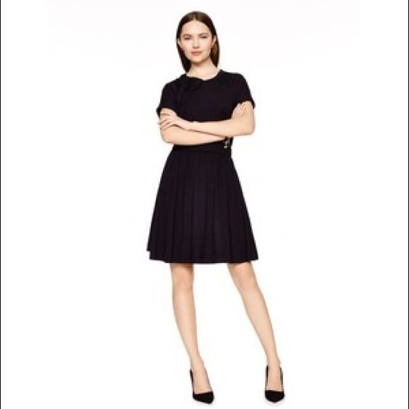 Kate Spade Drapes Jersey Dress Soft jersey dress with a round high neckline and a cute hand draped now detail near the collar. Elastic that hits around the waist to give the dress shape. Nice weight for spring/summer! Short sleeves with rolled detail on cuffs. kate spade Dresses Midi