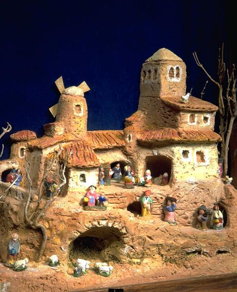 Traditional creche from Provence, France. The people and architecture of village life are figured into the story of the nativity of Jesus.