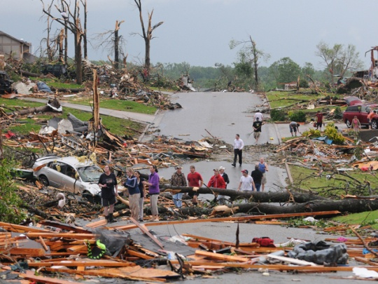 he road I took to get to my friends house that night...This looks exactly like tResidents of Joplin, Mo., survey the damage after a tornado hit the city on Sunday, May 22, 2011. The tornado tore a path a mile wide and four miles long destroying homes and businesses.