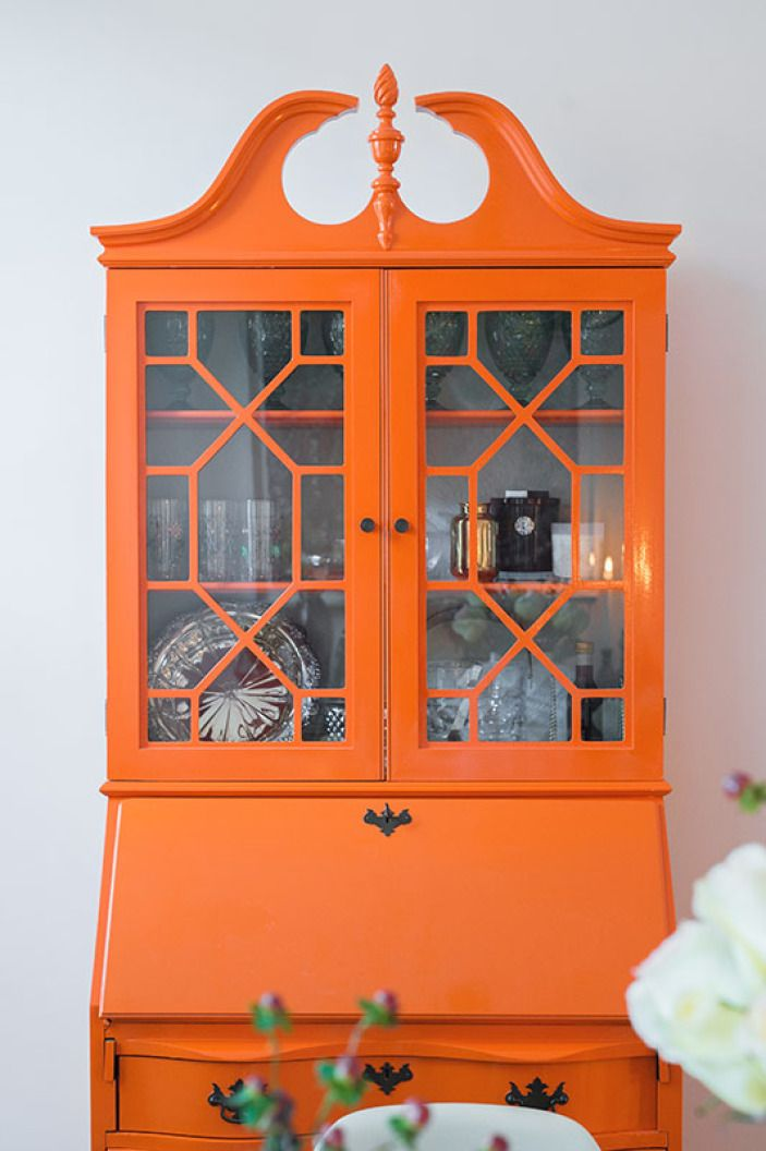 The armoire heirloom was give a high-gloss orange update.