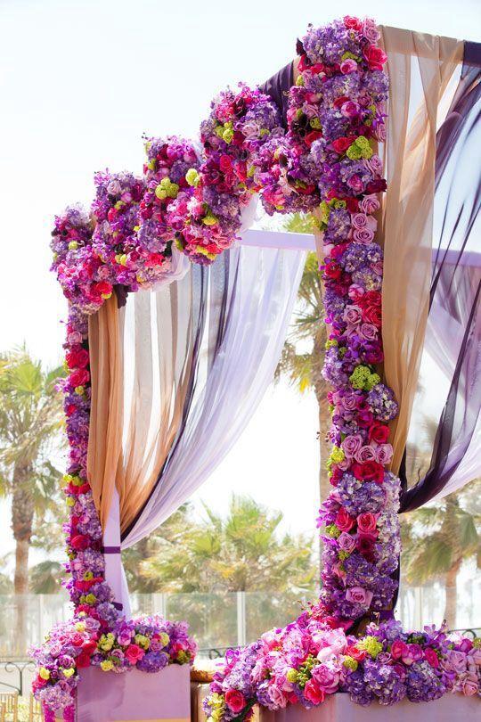 Great flower work!  #wedding alter mandap  #purple and pink wedding decor