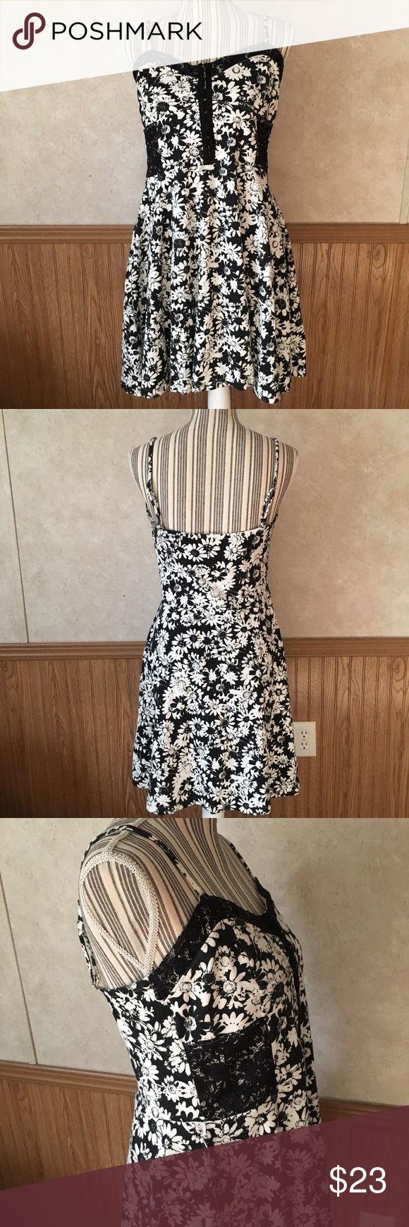 Black and white floral mini dress Soft fabric black and white floral mini dress with adjustable straps, lace accents, and corset closure front. Dresses Mini