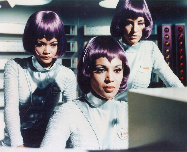 Moonbase gals of 1970s tv series UFO with v-bangs and purple hair/wig