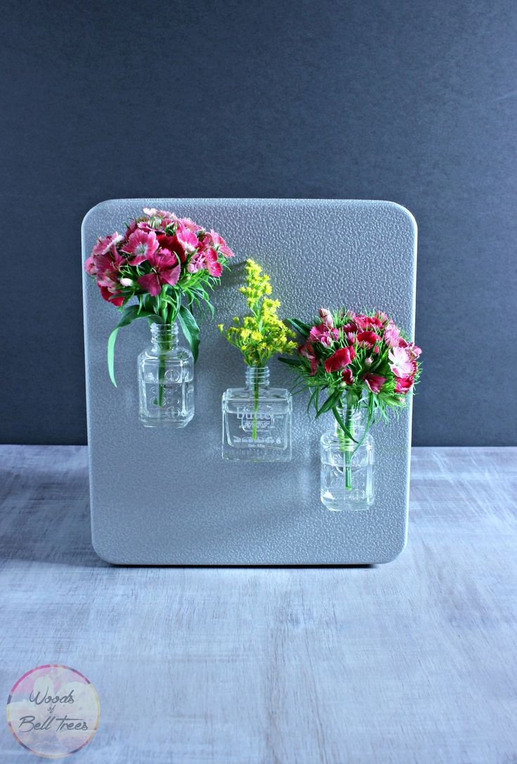 DIY magnet vase out of old nail polish bottles
