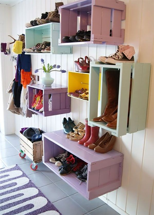 One way to repurpose wine crates when decorating and furnishing your entryway is by converting them into storage for shoes and accessories. You can paint each crate an attractive color, mount them all on a wall and use them as box shelves.