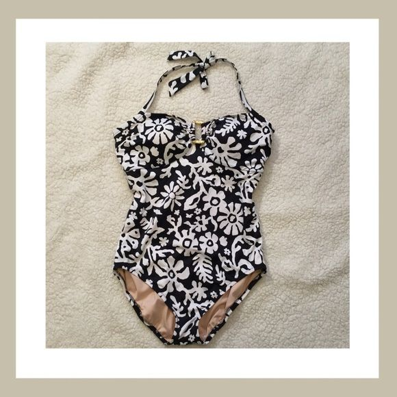 Just in  Lands End Swimsuit Black and white halter neck one piece swimsuit from Lands End. Size 14. Padded bra (not removable pads). 82% Nylon. 18% Lycra. 15% off two items or more.  Trades  PP. Reasonable offers always welcome Free shipping with orders over $75  FREE gift  with purchase (any one $10 or under item from my closet) Lands' End Swim One Pieces