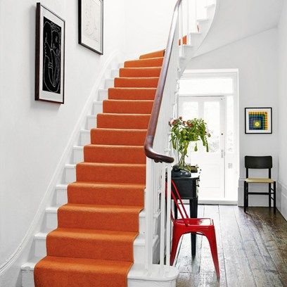 Orange is the New Black - Fresh white walls and a rustic wood floor is the perfect canvas for your design ideas. If you're going for a bold, bright statement colour, monochrome accents are a chic touch.