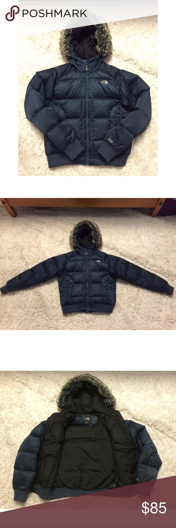 Women's North Face Down Winter Jacket Women's North Face puffy down winter jacket in excellent gently used condition. Gorgeous blue color. Only worn for 1 winter. The style of the jacket is fitted. The hood has a detachable faux fur lining. No stains, rips, or tears. North Face Jackets & Coats