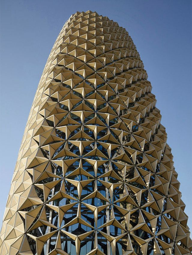 Al Bahar Towers : Aedas Ltd. Each module on the facade responds to the level of sunlight, opening and closing
