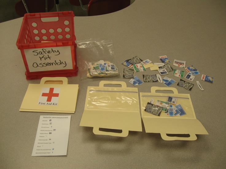Packing safety kits. Helps students learn about safety products, assembly and following directions. One of several practical skills found in Table Top Tasks.