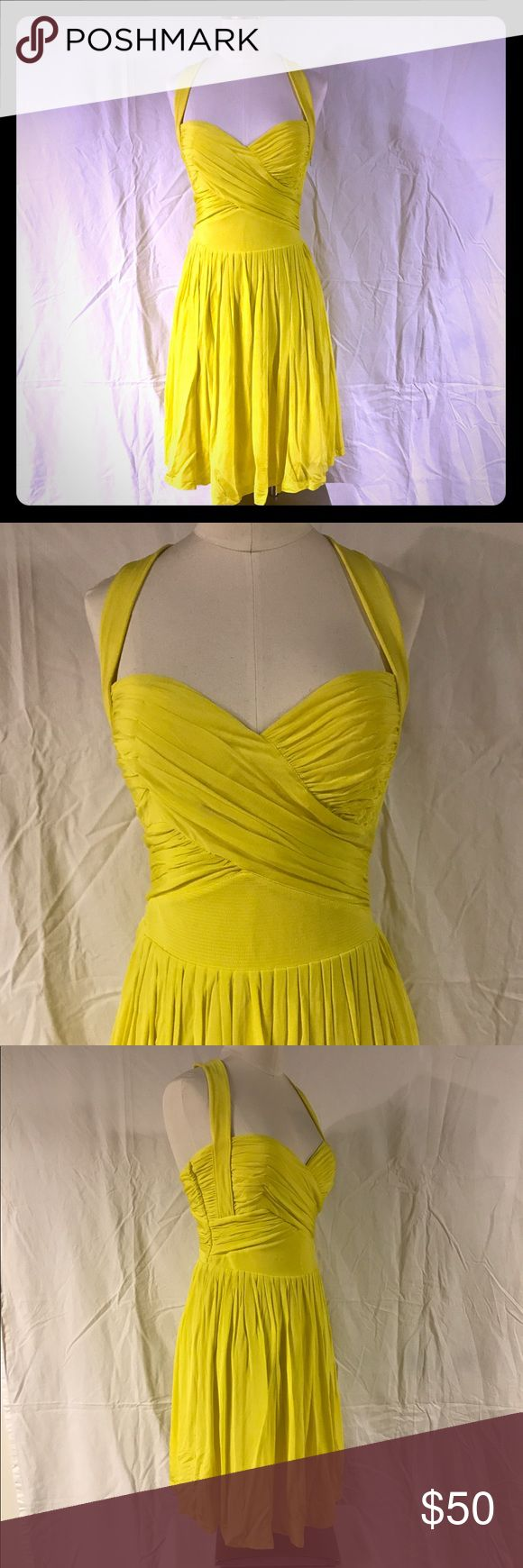 Bebe neon yellow dress Small EUC Bebe neon/bright yellow dress size Small. Fully lined, built-in bra pads, side zipper with hook and eye closure.  Knee length. Worn twice. Excellent used condition. Could use a good steam. Flowy, silk-like thin fabric, and so flattering. Perfect dress to wear to a wedding or night out! bebe Dresses Midi