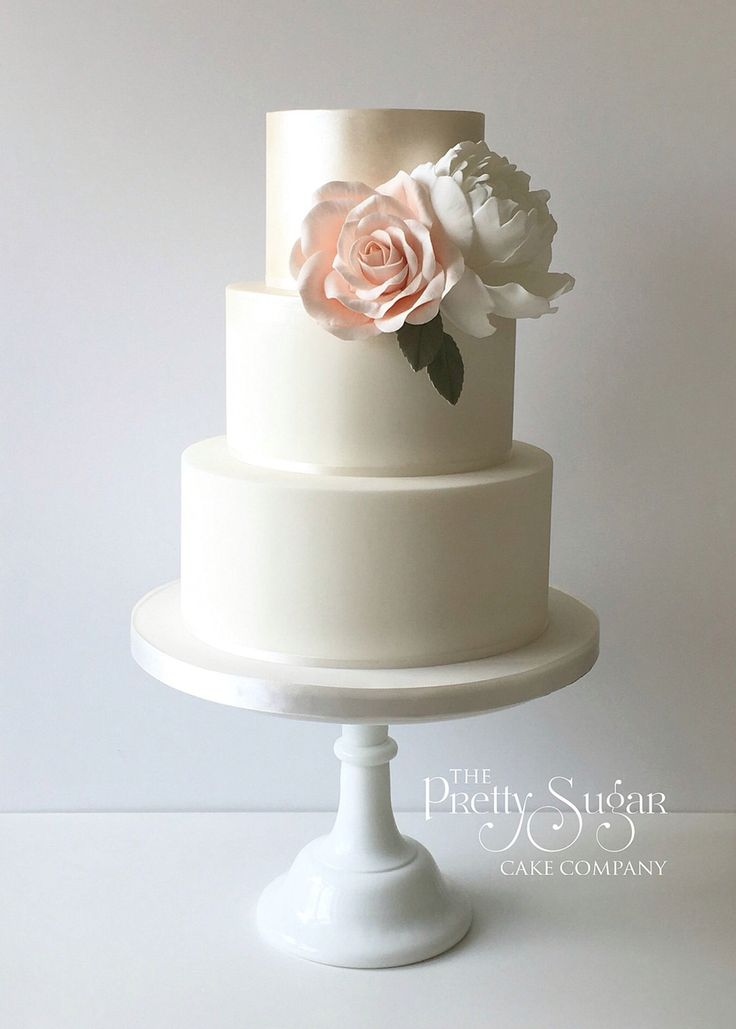 Pearl lustre wedding cake with statement blooms
