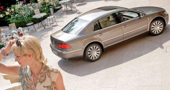 Sunny girl and sunny beige Volkswagen Phaeton