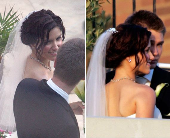 Sophia Bush wore her hair pulled back in a loose up-swept chignon. Her hair was gathered at the nape of her neck and pinned back with a few loose strands in the front. See more photos of Sophia Bush and Chad Michael Murray's wedding.