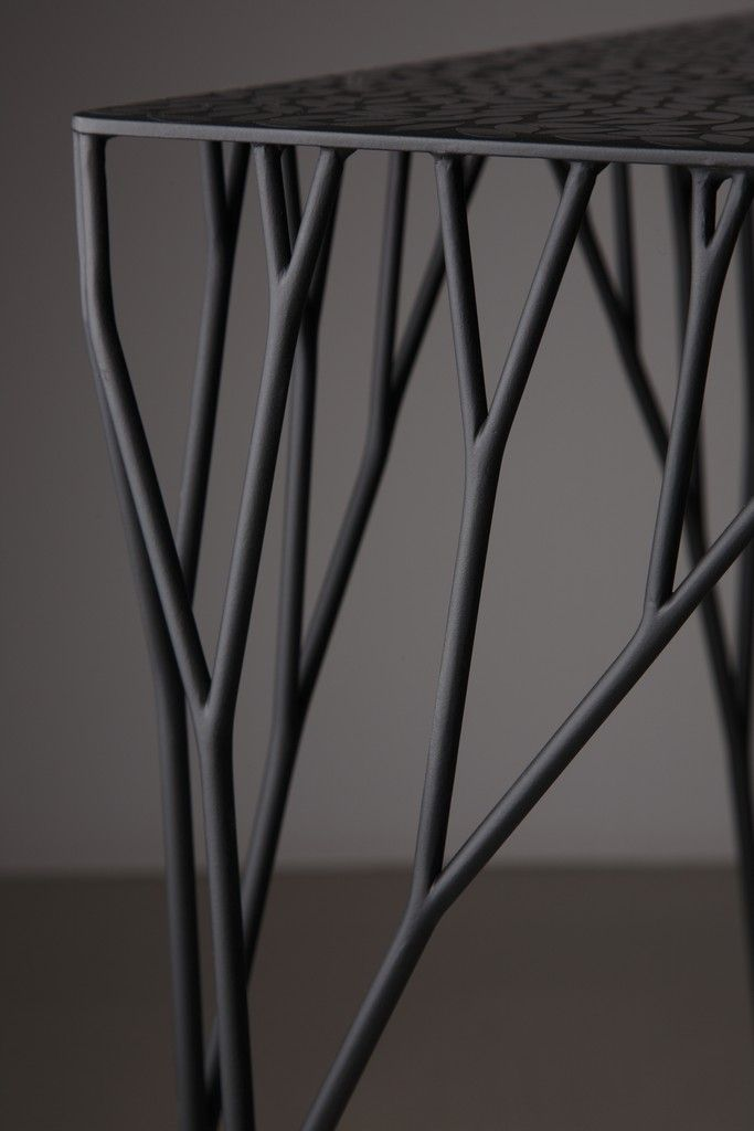Tree branch metal table http://www.arthitectural.com/wp-content/uploads/2012/07/arborism4.jpg