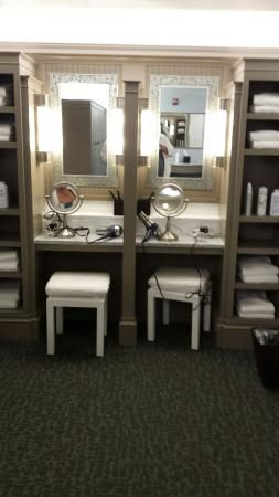 Fully stocked vanities in the luxurious spa locker room.
