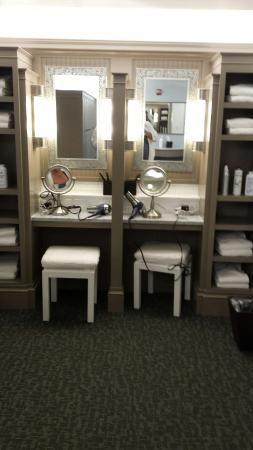 Fully stocked vanities in the luxurious spa locker room.