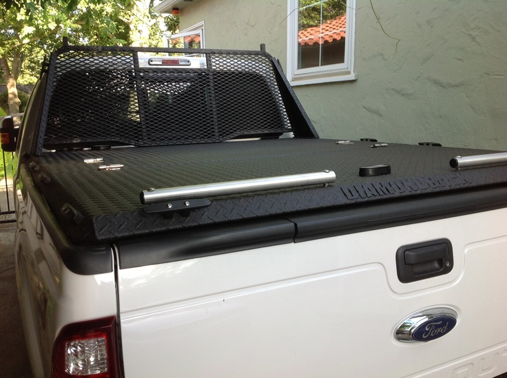 Diamondback Truck bed cover. 1600 lb capacity, w/rear