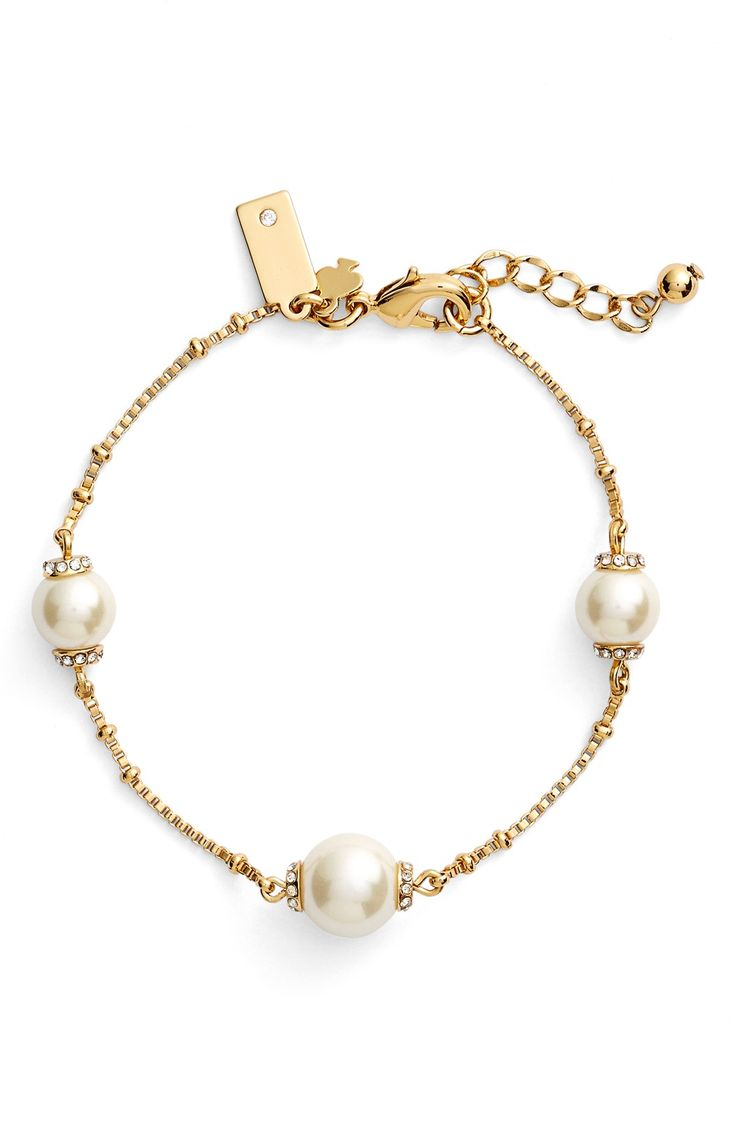 Adding some sparkle and glitz to the wrist with this glistening bracelet dotted with luminous faux pearls and dainty crystal-encrusted beads. Simple and dainty, this bracelet would look gorgeous on the day of the wedding.