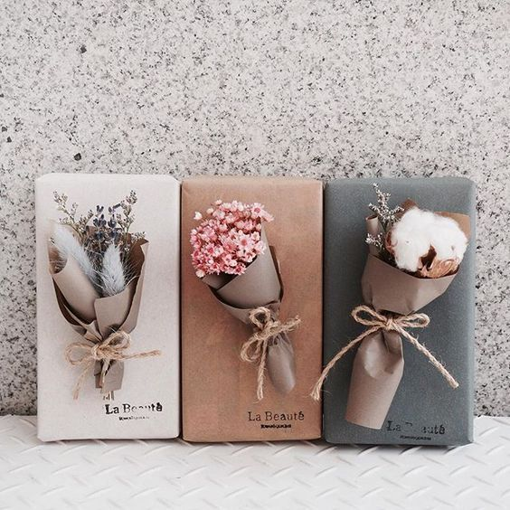 Adorable! Use some quality paper to curl up a bouquet of natural pieces as an accent #giftwrapping