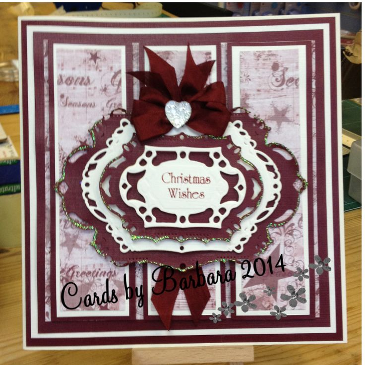 Made using Christmas background paper, spellbinder die edged with stickles, Christmas sentiment and bow & dazzler