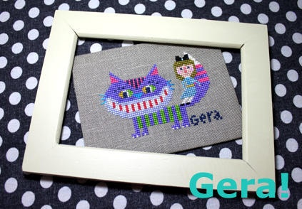 G era: cross stitch image of the Cheshire cat!