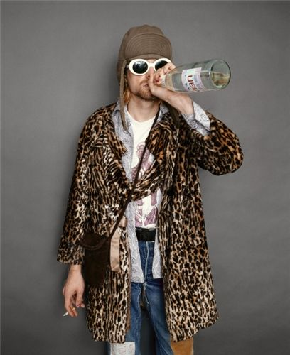 Kurt Cobain smokes a cigarette and drinks some Evian.