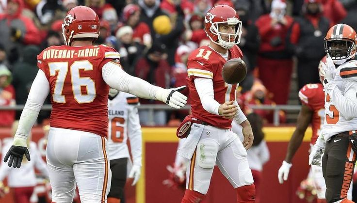 Kansas City Chiefs offensive guard Laurent Duvernay-Tardif (76) congratulated Kansas City Chiefs quarterback Alex Smith (11) as Smith flipped the ball back to an official after scrambling for a first down in the second quarter during the Kansas City Chiefs and Cleveland Browns football game at Arrowhead Stadium on December 27, 2015 in Kansas City, Missouri.