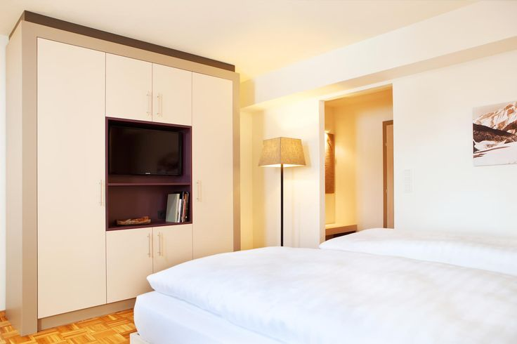 Hotel Post - EGGER Decors being used to create a contrasting look within a bedroom setting.