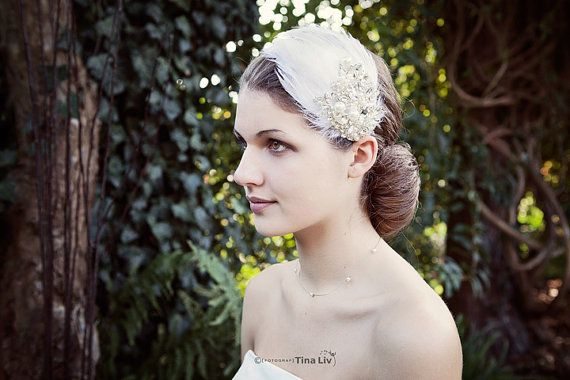 So sweet bridal hair piece with feathers, pearls and rhinestones